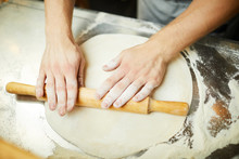 Overview Of Baer Hands With Rolling-pin Rolling Fresh Handmade Dough For Pizza