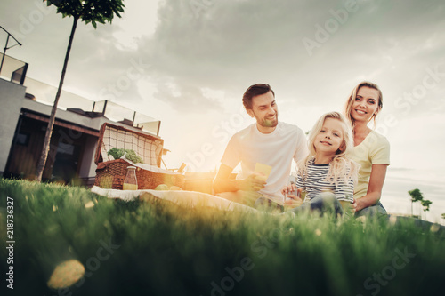 Valokuva  Low angle portrait of beaming bearded man talking with cheerful wife
