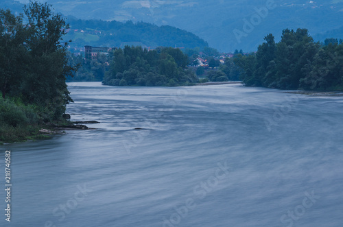 Foto op Aluminium Blauwe jeans View on the flowing Drina river at sunset