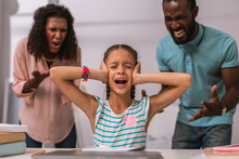 I Dont Want To Hear. Unhappy Stressed Out Girl Covering Her Ears While Not Wanting To Listen To Her Parents