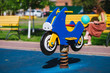 A toy motorcycle is installed on the playground
