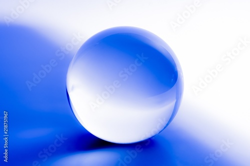 Fotografie, Tablou Glass ball in abstract blue