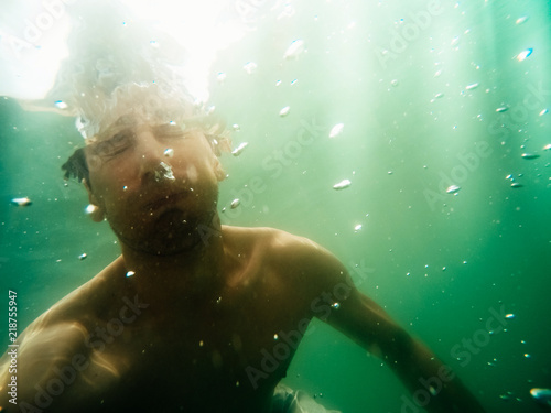 Staande foto Duiken Man underwater diving