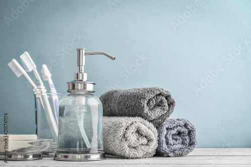 Bathroom set with toothbrushes, towels and soap