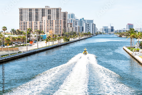 Hollywood, Florida in Miami beach Broward area with cityscape skyline of residential skyscrapers coastal buildings, aerial view of bay, Stranahan River, boat, sunny day