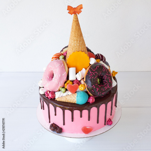Cake With Pink Cream In Chocolate For Childrens Birthday Sweets Decorated Waffle Cone Marshmallows Donuts Hearts Butterflies Popcorn