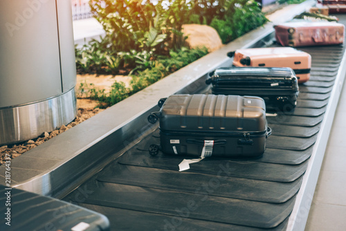 Fotografie, Obraz  Suitcase or luggage with conveyor belt in the international airport