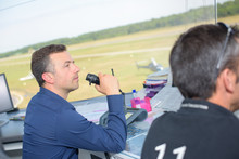 Control Tower Worker Talking Into Receiver
