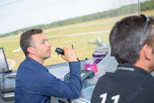 Obraz na płótnie Control tower worker talking into receiver