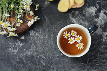 Cup Of Delicious Camomile Tea On Grey Table
