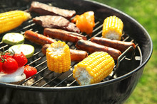 Tasty Meat With Vegetables And Sausages Being Cooked On Barbecue Grill Outdoors, Closeup