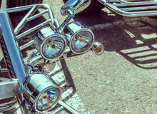 Chromed Headlights On The Front Fork Of A Trike