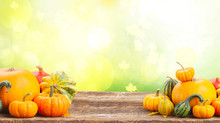 Pile Of Orange Pumpkins On Wooden Table Over Fall Background Banner With Copy Space