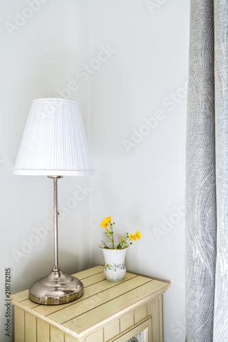 Fotografie, Obraz  Closeup of modern nightstand in bedroom, room with side stainless steel lamp, fl