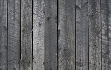 Grungy Background Of Peeling Flaking Black Paint On Wooden Boards