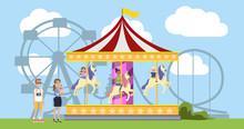 Children Having Fun On The Merry Go Round