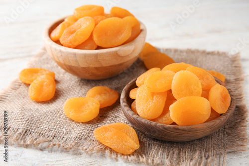 Photo Bowls with dried apricots on table