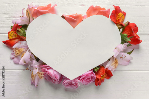 Heart Shaped Sheet Of Paper With Beautiful Flowers On White Wooden