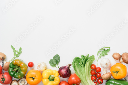 top view of ripe vegetables and herbs isolated on white