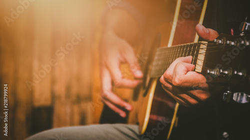 hand playing acoustic guitar, close up on musical instrument Relaxation Music sound hobby passion concept. - 218799924