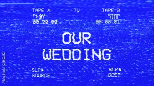 Fotografia, Obraz  An old damaged VHS tape tracking a bad signal coming from a double deck, with the text Our wedding