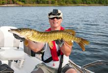 Happy Angler With Sea Pike