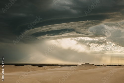 Cadres-photo bureau Desert de sable Moody desert sky in evening