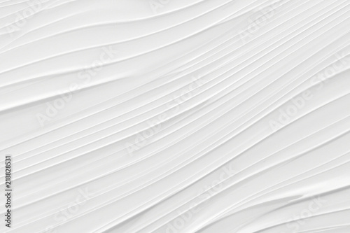 Fototapeta Drawing of a wave of white and gray color. Background with stains and curved lines.