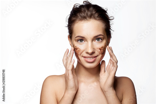 Fotografía  Girl with peeling cosmetic product on beauty face on white background
