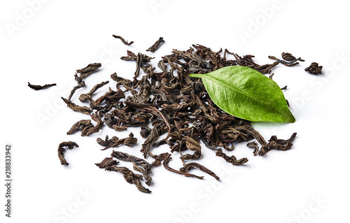 Staande foto Thee Heap of dried black tea leaves isolated on white background.