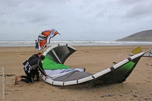 Kitesurfers preparing kites