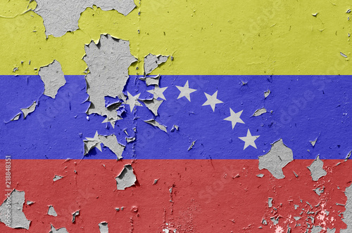 Fotografía  Flags of Venezuela is painted on brick wall background