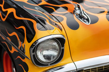 An Old Muscle Car With A Flame...