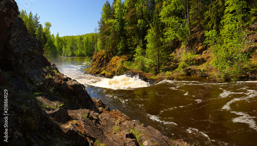 Panorama of the stormy river with rapids