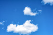 Fluffy white clouds on background of blue sky wallpaper