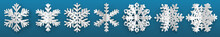 Set Of White Three-dimensional Paper Snowflakes On Light Blue Background