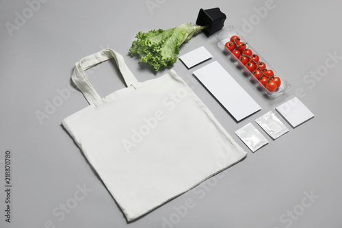 Composition with items for mock up design on gray background. Food delivery service