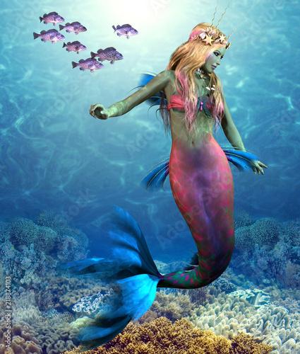 Coral Reef Mermaid - A school of Blue Rockfish swim along side of a beautiful mermaid as she glides along an ocean reef.