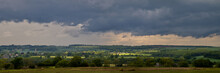 Purple Grey Skies And Green English Countryside Panorama