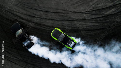Photographie Aerial top view two cars drifting battle on race track, Two cars battle drift, Race cars view from above
