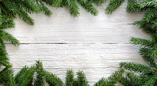 Christmas Background With Fir Branches On White Wooden Board