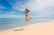 The woman is happy and jumps on her holiday.