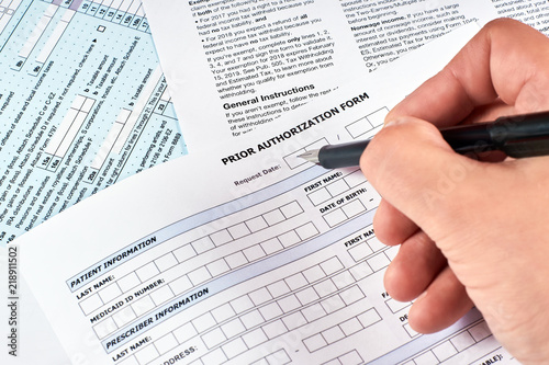 Fototapeta Human fills a prior authorization form