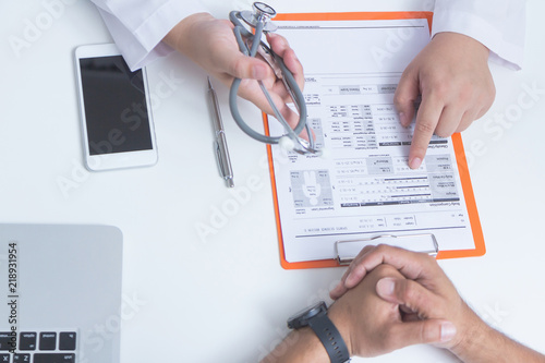 Fototapety, obrazy: Doctor and patient are discussing something.- Health care concept