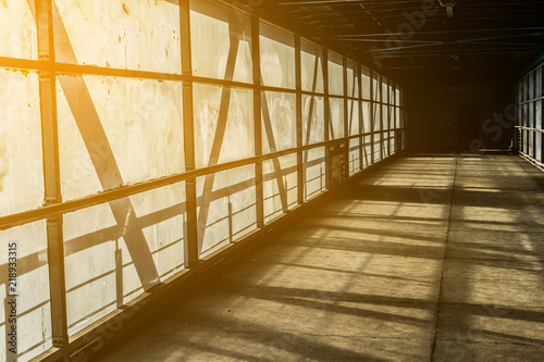 Wall Murals Stairs Modern overhead passage from steel and glass, perspective, long tunnel in sunset light