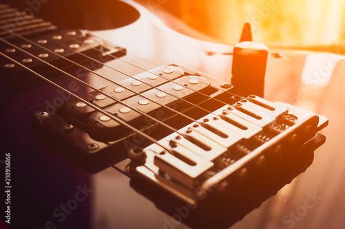 Fotografie, Obraz  electric guitar close-up. sun glare