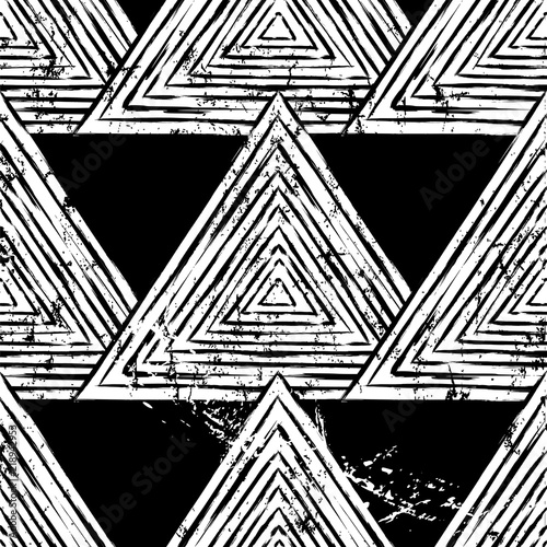 seamless geometric background pattern, with triangles, paint strokes and splashes, black and white