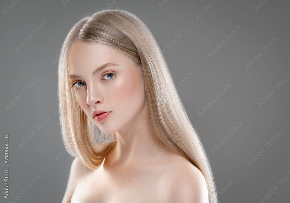 Fototapeta Beautiful Woman Face Portrait Beauty Skin Care Concept with long blonde hair  over gray background