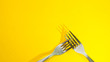 canvas print picture - forks and shadow on yellow background