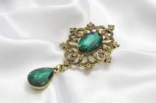 Golden Vintage Brooch With Eme...